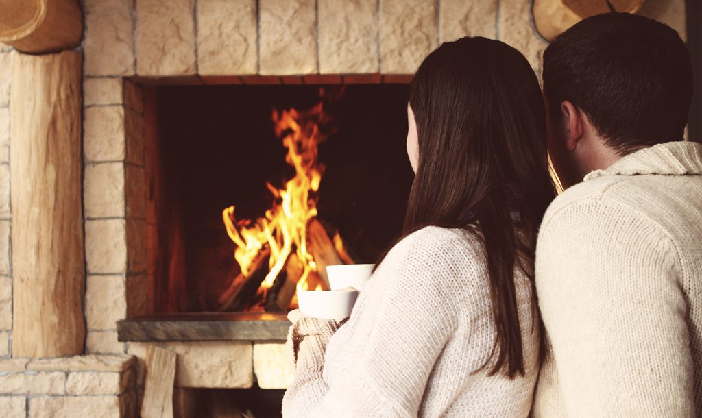 Couple in front of warm fire