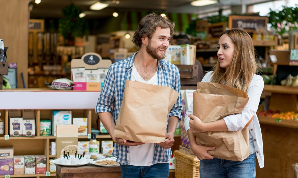 Man and woman shopping with paper bags