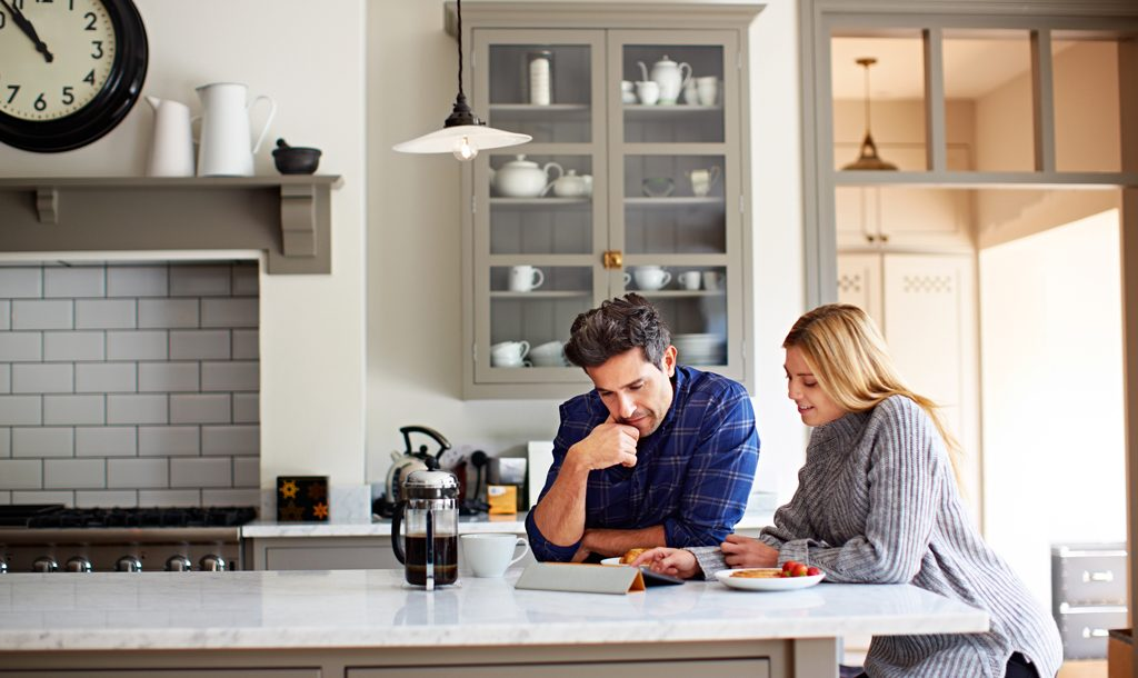 Man and woman sitting in their kitchen