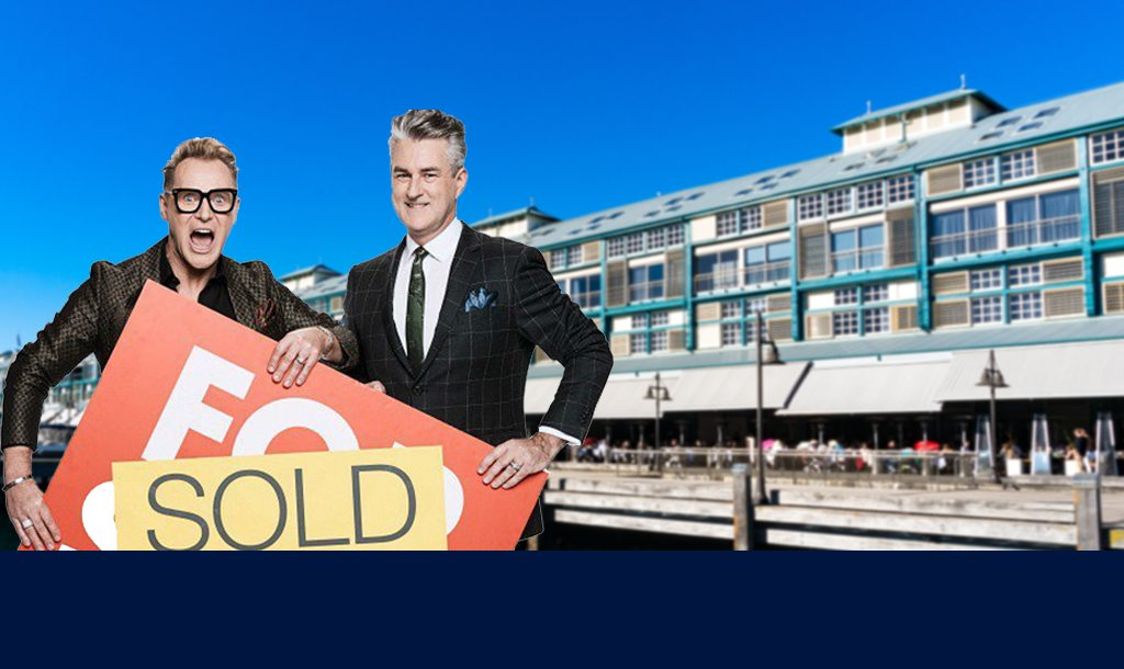 Picture of Mitch and Mark with a sold sign outside Potts Point